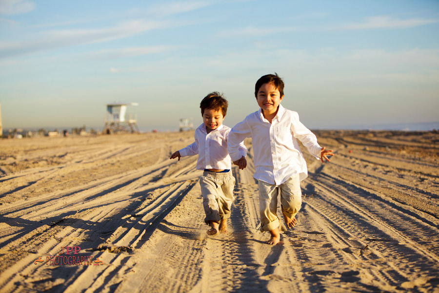 Sibling Brothers Running On The Beach Portrait