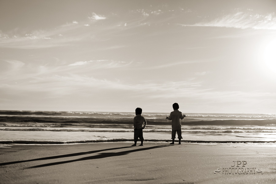 Timeless feel lifestyle photo of 2 kids on the beach in Huntington